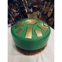 Butone tongue drum. 13 note in Fmaj Pent. Green and gold. With ring but no bag.